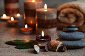 Stones and aromatherapy candle — Stock fotografie