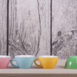 Cups on table over wooden background — Stock Photo #45390753
