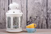 Lantern candle holder and cups vintage — Stock Photo