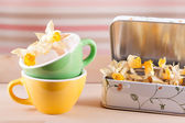 Colored cups with a box and daffodils vintage retro — Foto de Stock