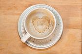 Empty cappucсino coffee cup with heart — Stock Photo