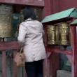 People touching the prayer wheels near the Gandan Monastery — Stock Video