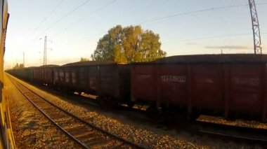 Train passing by a goods-train end of the day — Stock Video