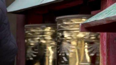 Hand touching the prayer wheels near the Gandan Monastery — Stock Video