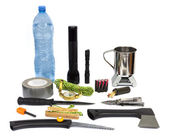 Survival kit with emergency supplies — Stock Photo