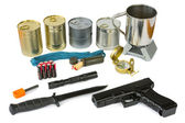 Survival kit with emergency supplies, flashlight and gun — Stock Photo