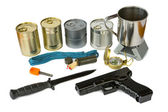 Survival kit with emergency supplies and gun — Stock Photo