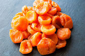 Dried apricots on black background — Stock Photo