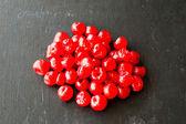 Dried cherries on black background — Stock Photo