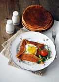 Buckwheat galette with sunny side up egg — Stock Photo