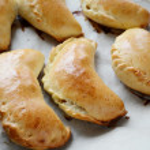 Pierogi or pirogi: baked stuffed pastries — Stock Photo #48817497