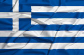 Greece flag on a silk drape waving — Stock Photo