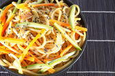 Serving of spaghetti with carrots and zucchini and soy sauce and — Stock Photo