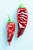 Dryed chili peppers on a light blue background — Stock Photo
