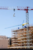 House exterior in construction and crane — Stock Photo