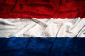 Netherland grunge flag on a silk drape — Stock Photo