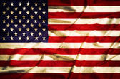 United States grunge  flag on a silk drape — Stock Photo