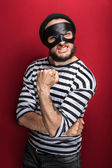 Portrait of a angry bandit threaten with a fist — Stock Photo
