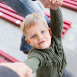 A beautiful little boy looking up at his parents, holding hands — Stock Photo