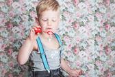 Portrait of funny little boy blowing soap bubbles — Stock Photo