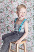 Portrait of funny little boy laughing — Stock Photo