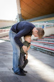 Father and son playing in empty stadium — Stock Photo