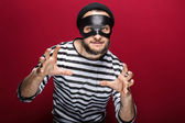 Masked criminal ready to fight — Stock Photo