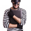 Thief stealing a laptop computer — Stock Photo #48158189