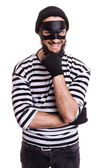 Crafty robber smiling and thinking — Foto de Stock