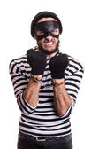 Angry burglar with handcuffs — Stock Photo
