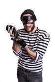 Happy thief holding stolen jewelry — Stock Photo