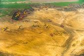 Wheel loader Excavator unloading sand, tractors and dump truck i — Foto de Stock