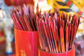 Red bamboo stick for shaking, ancient chinese fortune telling ca — Stock Photo