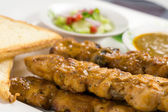 Chicken satay with bread — Stock Photo