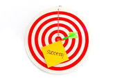 2 dart green and yellow color right on target with text success — Photo