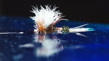 Fly fishing dry flies floating on water — ストックビデオ