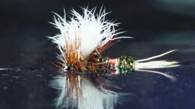 Fly fishing dry flies floating on water — Stok video