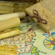 Diary with map and paper scrolls — Stock Photo