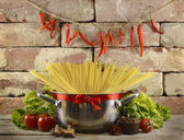 Kitchen still life with pot and spaghetti — Stock Photo