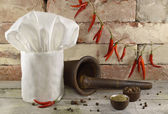 Vintage pepper background with toque — Stock Photo