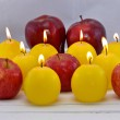 Apple and candles — Stock Photo #45755187