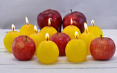 Apple and candles — Stock Photo