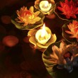 Lotus flower and burning candles — Stock Photo #46185115