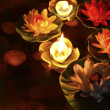 Lotus flower and burning candles — Photo #46185115
