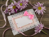 Pink greeting card with flowers — Stock Photo