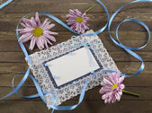 Blue greeting card with flowers and lace — Stock Photo