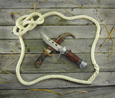 Rope frame with knives — Stock Photo