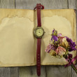 Old diary with clock and flowers — Stock Photo