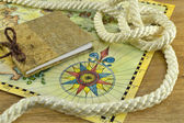 Book with sea rope and map — Stock Photo