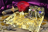 Pirate treasures with map and knife — Stock Photo